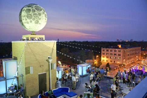 The stunning Rooftop Terrace Bar at the Moonrise Hotel offers a dramatic view of the bustling Delmar Loop district and St. Louis skyline. Enjoy signature cocktails and appetizers under the world's largest man-made moon.